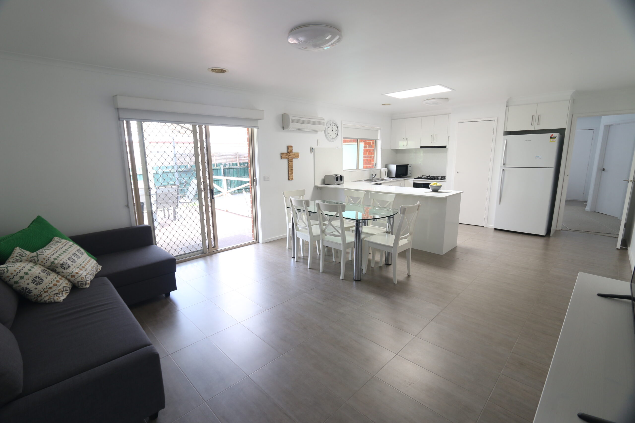 open plan kitchen, dining and living zones. Safety Beach holiday rental.