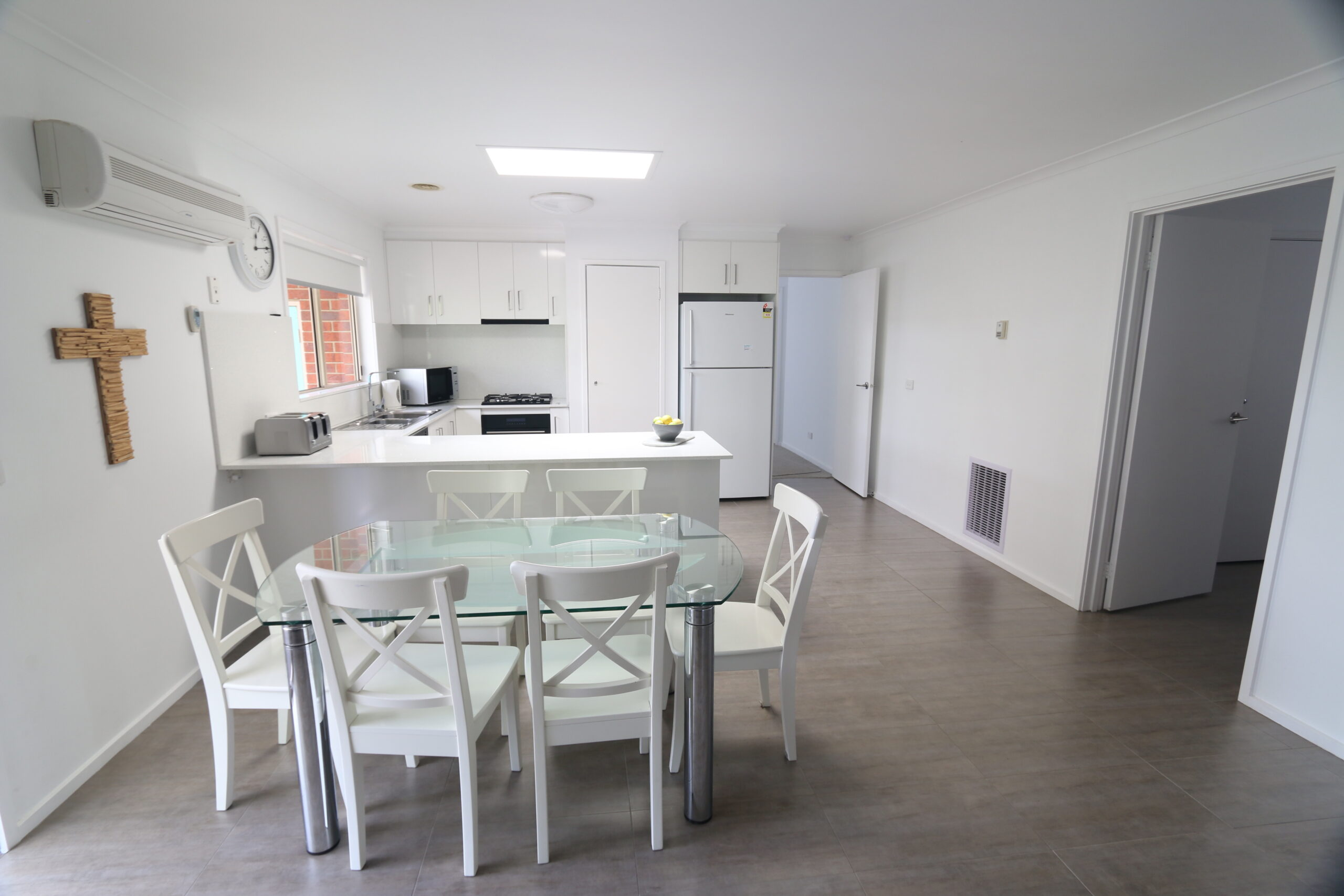 open plan kitchen and dining zones. Safety Beach holiday rental.