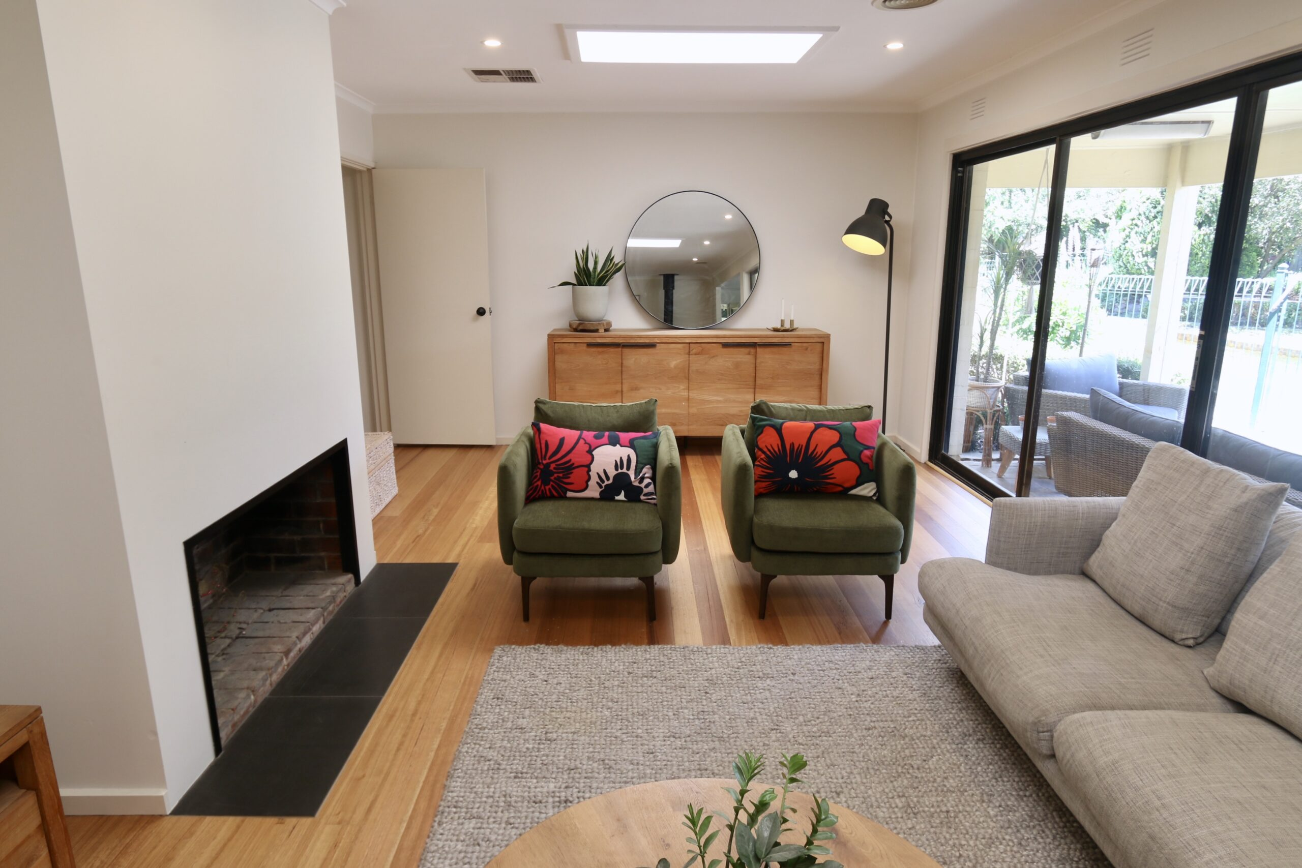 Main lounge room with bespoke green occasional chairs. Moorooduc holiday rental