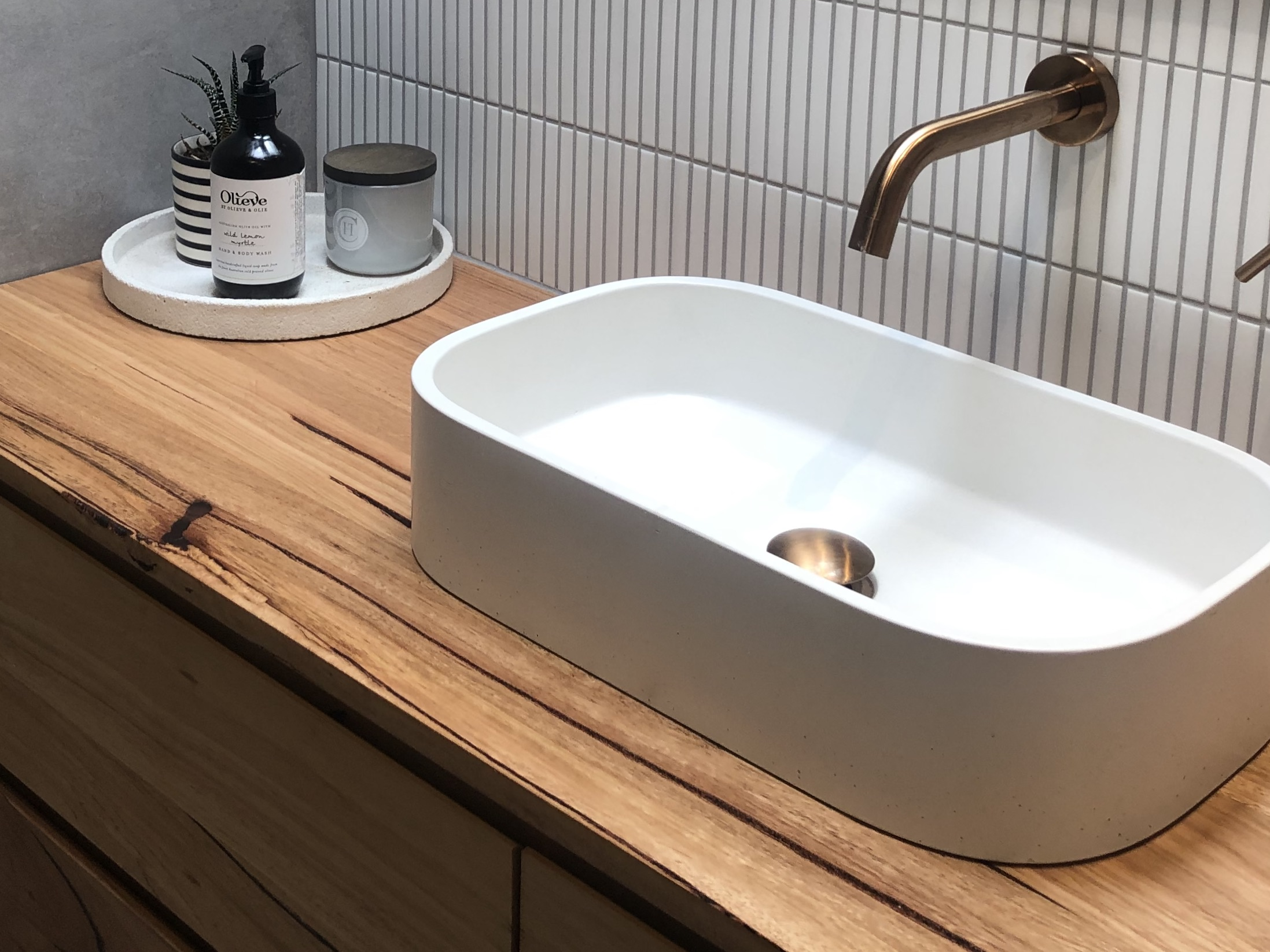 New master ensuite, vignette of basin with brushed brass taps